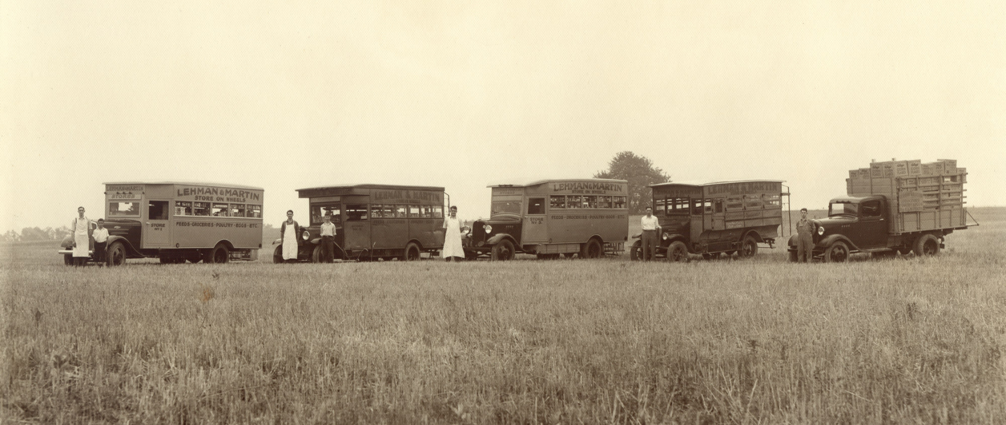 Black and white photo of Lehman and Martin Store on Wheels trucks