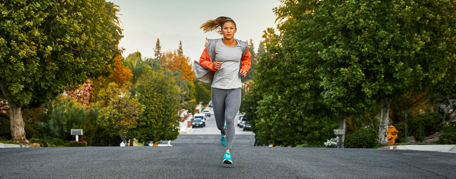 Girl running in a pair of Altra Shoes