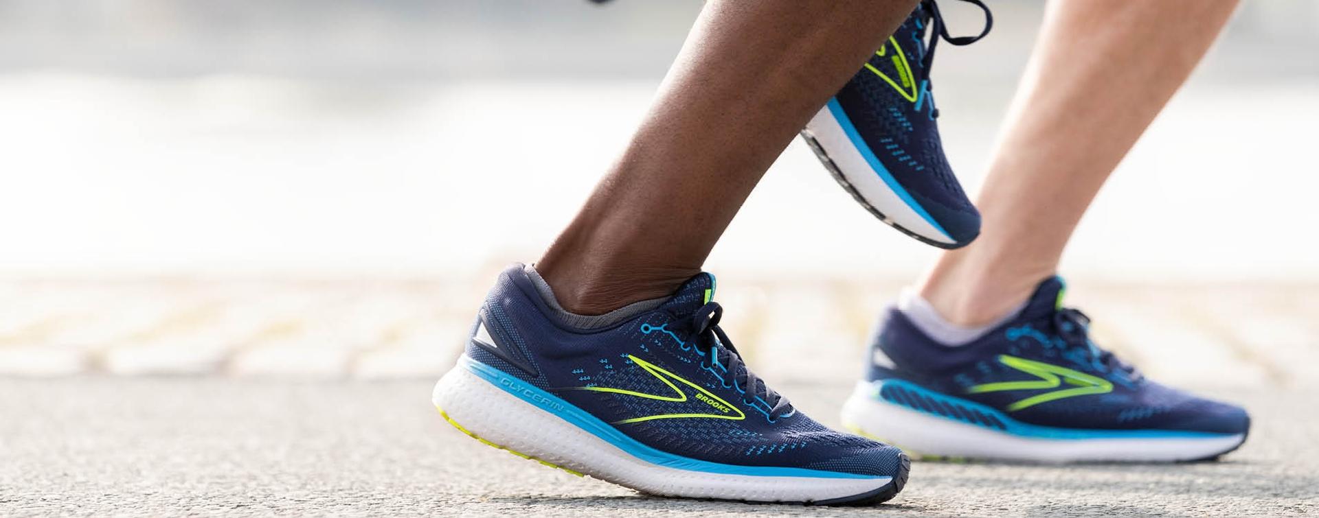 Close up of feet wearing Navy blue running sneaker