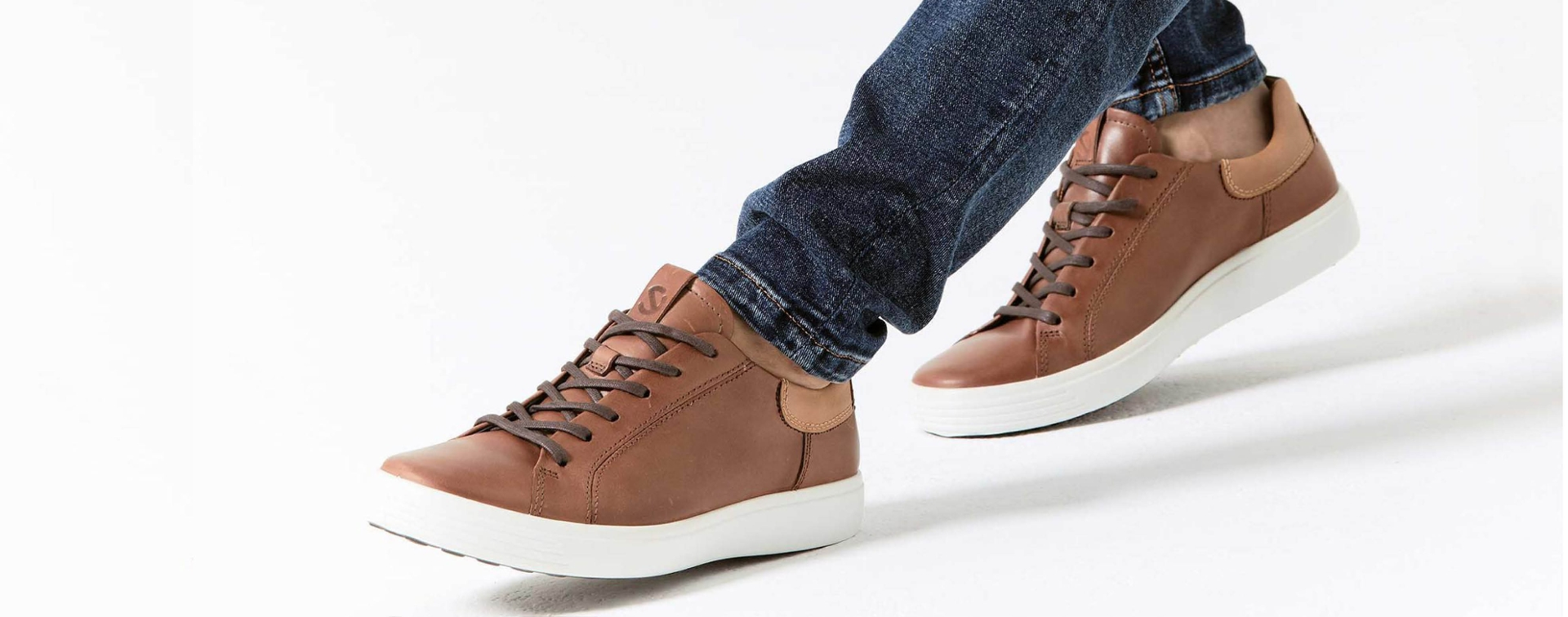 close up of brown leather sneaker on the foot.