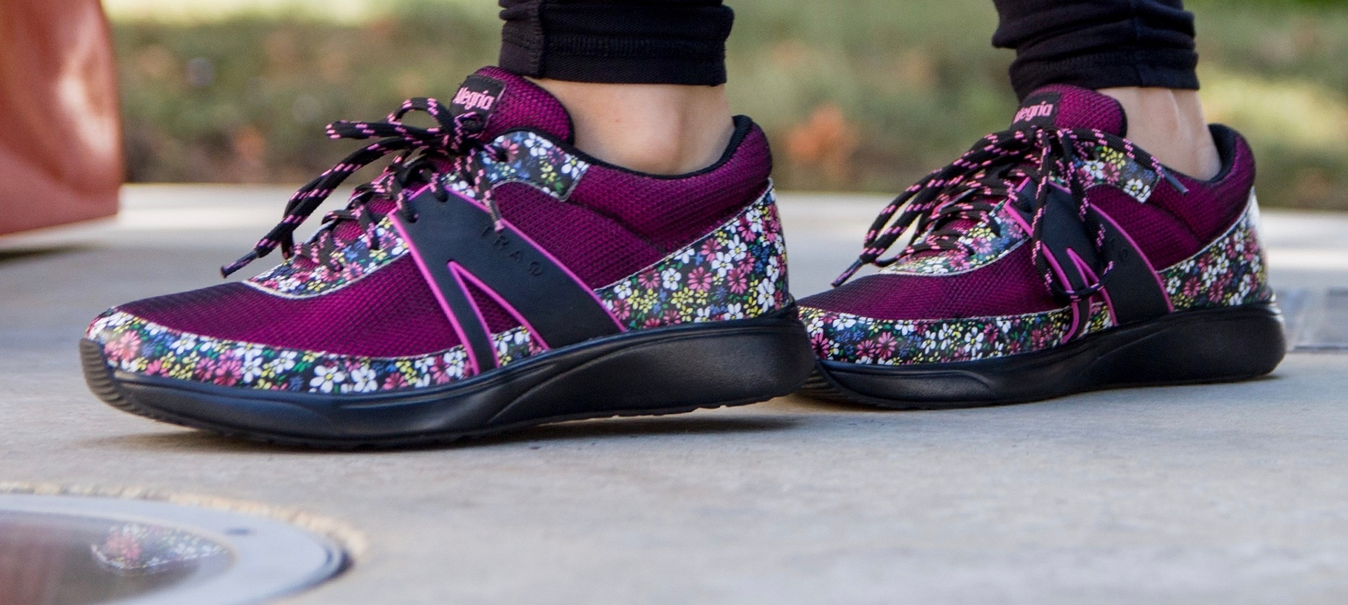 Purple athletic shoes with a floral print