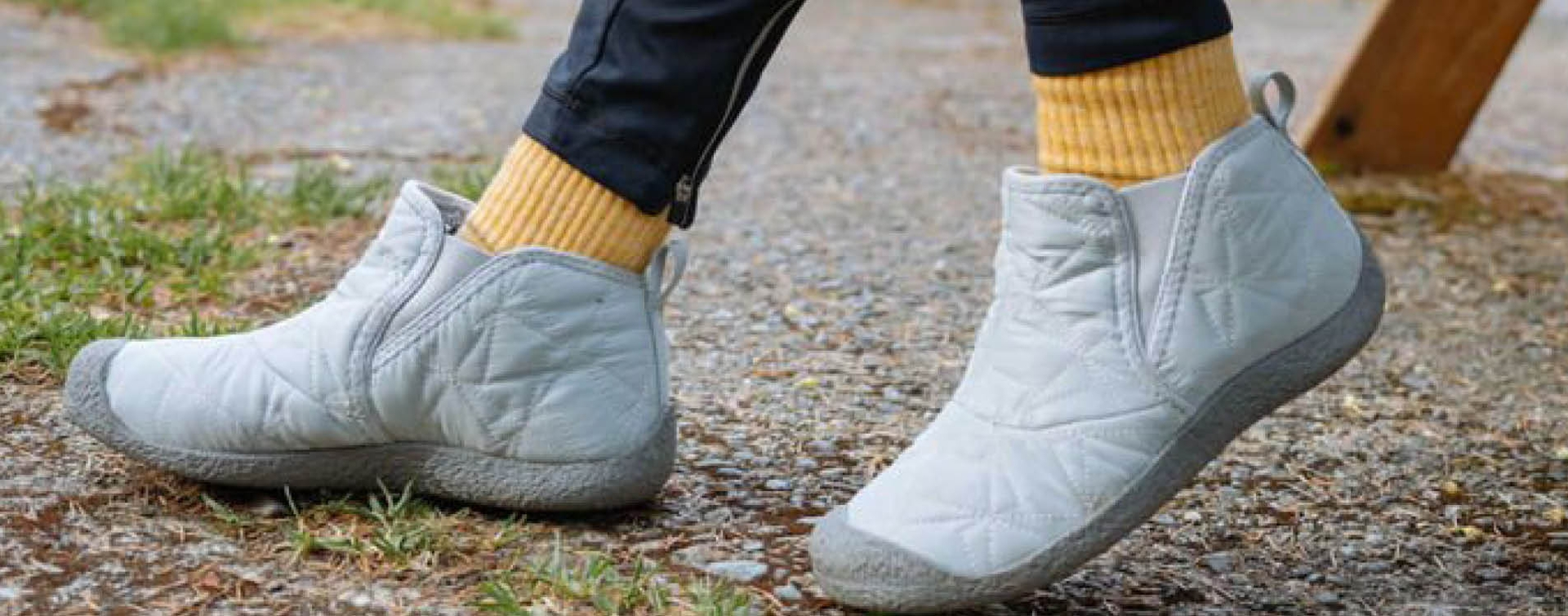 Close up of a guys legs with water sandals on.