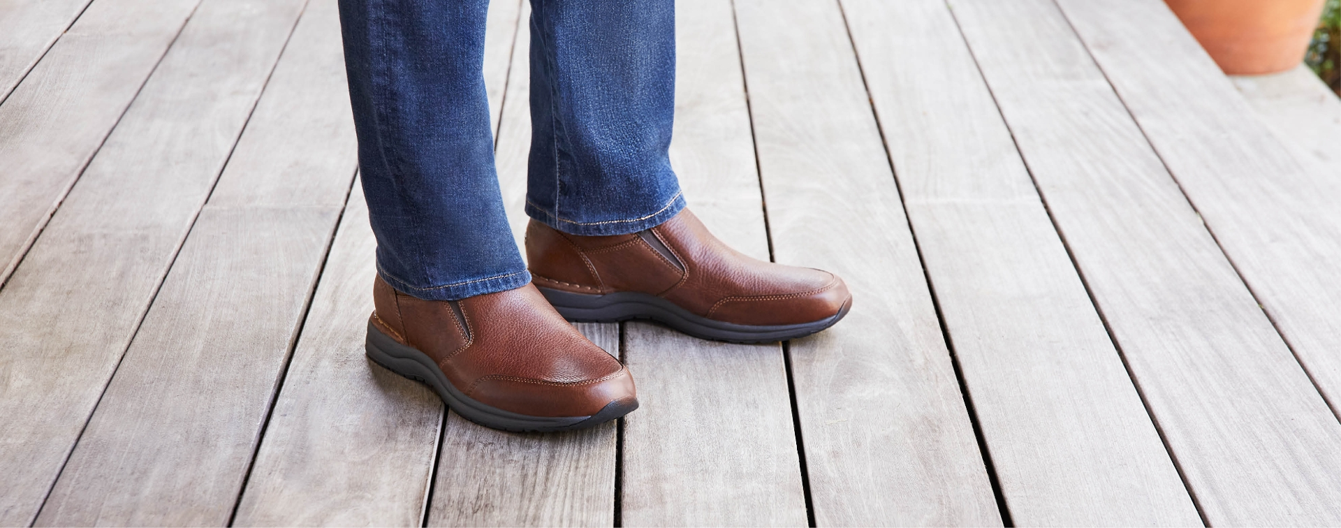 Close up shot of man wearing brown shoes